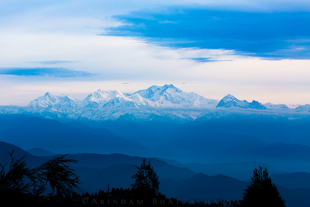 Cloudy sunrise of Kanchenjunga from the Tiger hill view point in Darjelling hills.