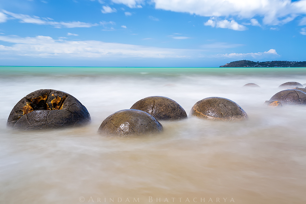 The Moeraki Boulders at the South Island of New Zealand near Otago. They are geological marvels of spherical shape, exposed by erosion of sedimentary rocks laid down from 65 million years ago.
